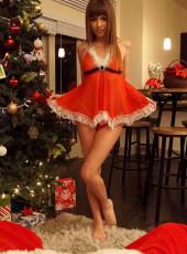 Cherie Deville dressed as Santa
