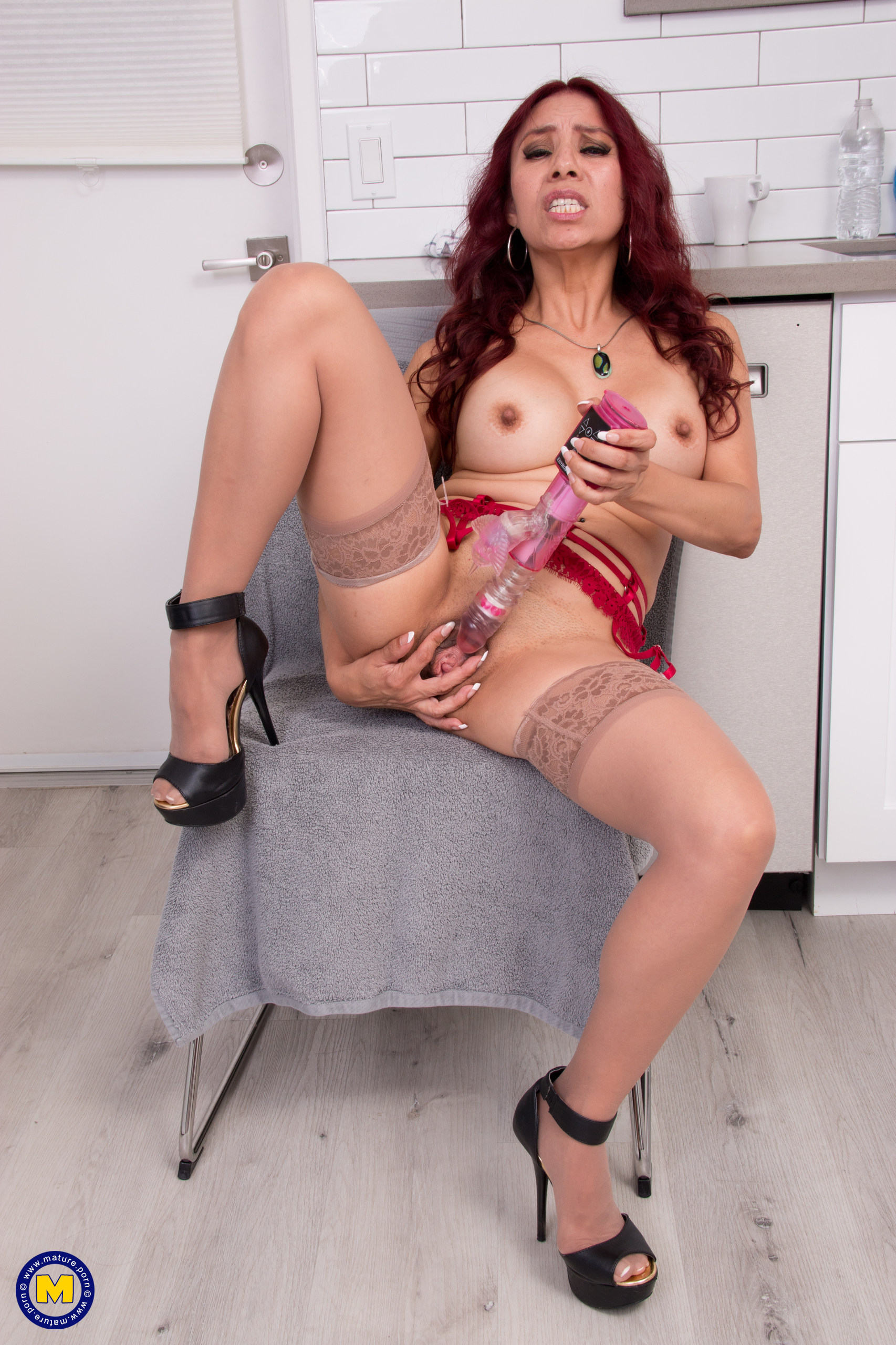 Redhead mature Claudia Fox