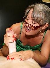 Milf Erica Lauren strokes large cock