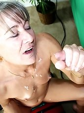Busty milf Shay stroking big cock for a signature