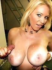 Johnny has a monster sized cumload for the sexy milf Sheila Marie as she whips out her massive rack and proceeds to make his cock