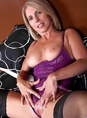Elegant homemaker spreads her delicious smooth-shaven pussy and fucks a toy