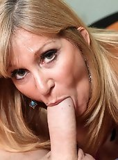 Blonde panther Andi Roxxx teases her milf pussy along with her fingers