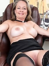 Hot and attractive football game female parent plays along with her juicy twat ahead of her neighbors