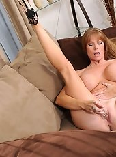 Sensual panther American state Skye fondly torments her bald mature pussy with the purple rabbit