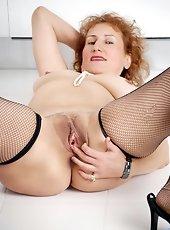 Eva Karera slips off her lace underwear outdoors unleashing her elegant milf beauty