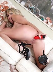 Hot blonde MILF in black stockings spreads open her juicy smooth-shaven pussy