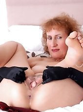 Gorgeous Anilos Gilly flaunts her sultry nude mature body in her room