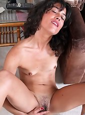 Sultry Mistress gets naked and plays along with her wet furry pussy