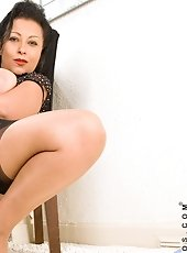 Naughty panther Karenic Wood slides off her thongs and fucks herself on the couch